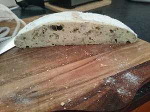 The obligatory crumb shot of my round loaf. The sandwich loaf rose a lot higher but only had little bubbles throughout it (none of the big bubbles like this).